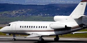 Book a private flight on a Falcon 900