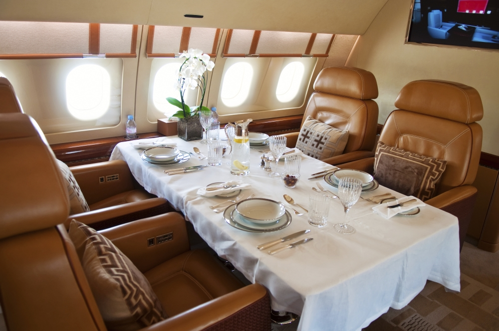 dinner served in luxurious jet airplane