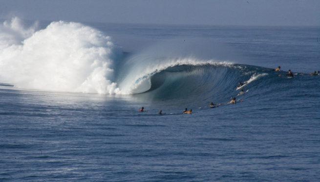 Surfing at Teahupo?o in Tahiti