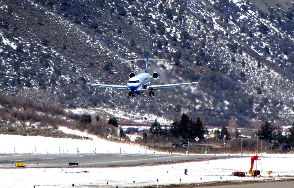 Emergency crews work near a passenger plane that crashed upon landing at  the Aspen-Pitkin